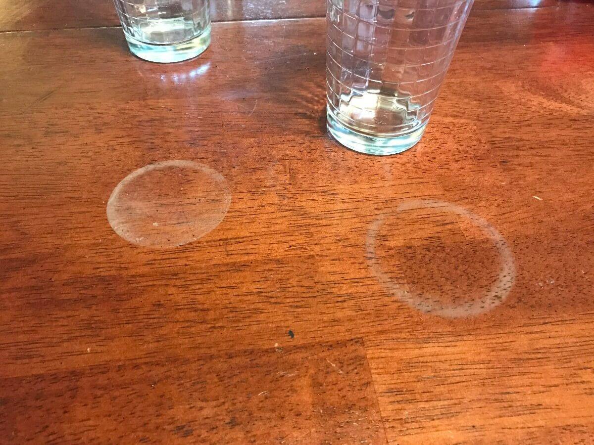 WHITE RINGS ON WOODEN TABLE FURNITURE