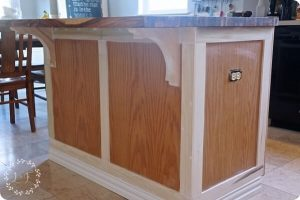 CUSTIMIZING A WOOD KITCHEN CABINET ISLAND MAKEOVER WITH TRIM