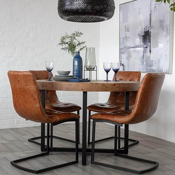 THE NATURAL CHARM STANDFORD RECLAIMED WOOD ROUND DINING TABLE AND LEATHER CHAIRS