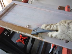 SCRAPING BEFORE PAINTING WOOD CABINET