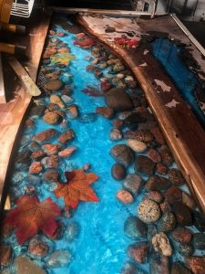 WOOD AND RESIN TABLE AUTUMN IN RIVER BANK