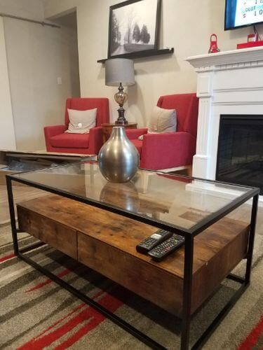 INDUSTRIAL PIECE WOOD AND GLASS COFFEE TABLE